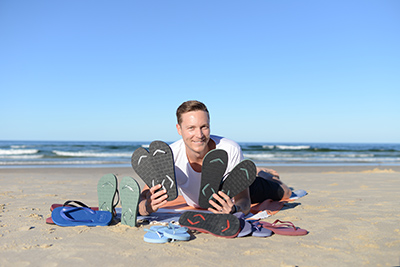 Brad Munro with his Boomerangz thongs collection.